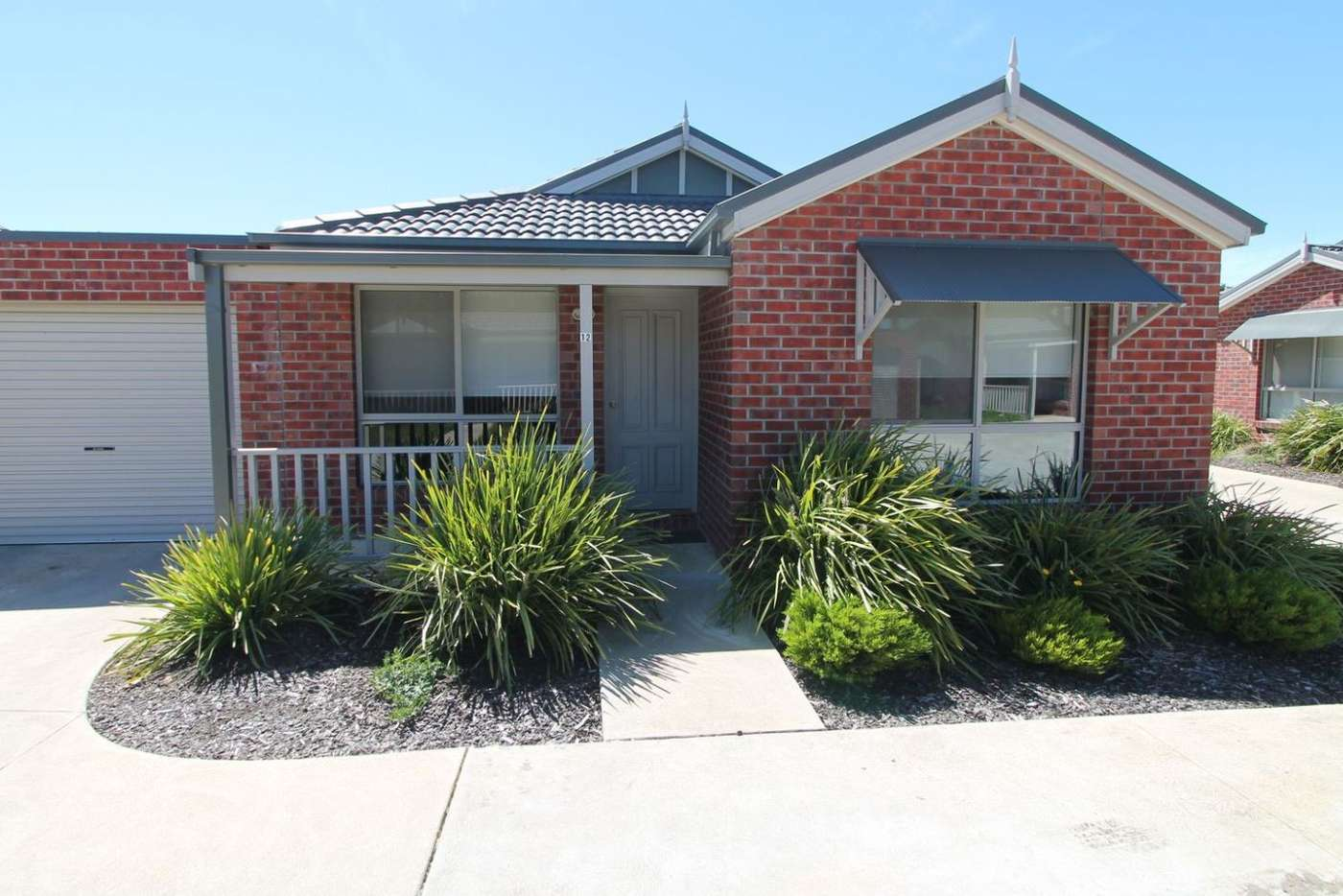 Main view of Homely townhouse listing, 12 Tristan Drive, Sebastopol VIC 3356