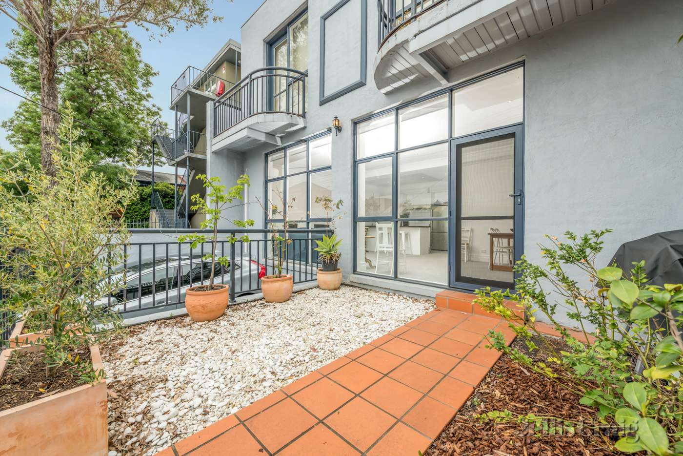 Main view of Homely townhouse listing, 1/64-68 Lyndhurst Street, Richmond VIC 3121