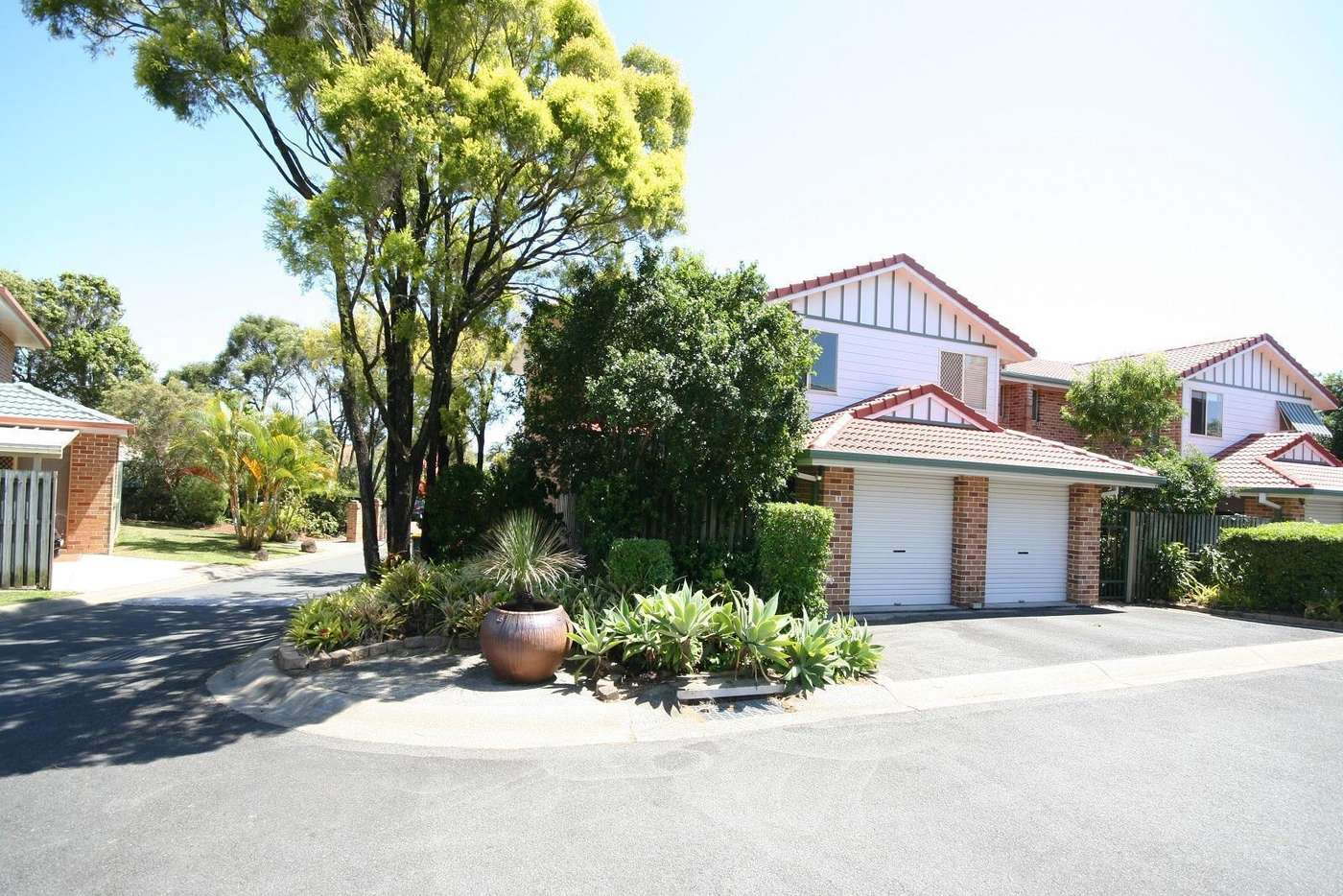 Main view of Homely townhouse listing, 1/17-21 Monterey Avenue, Banora Point NSW 2486
