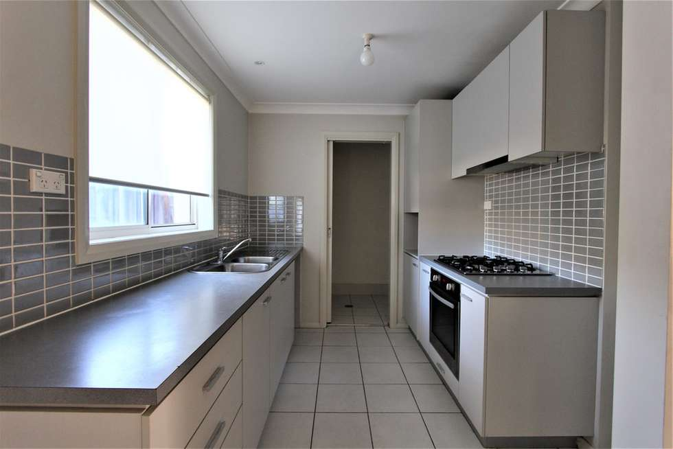 Second view of Homely house listing, 15 Hindostan Road, Glenfield NSW 2167