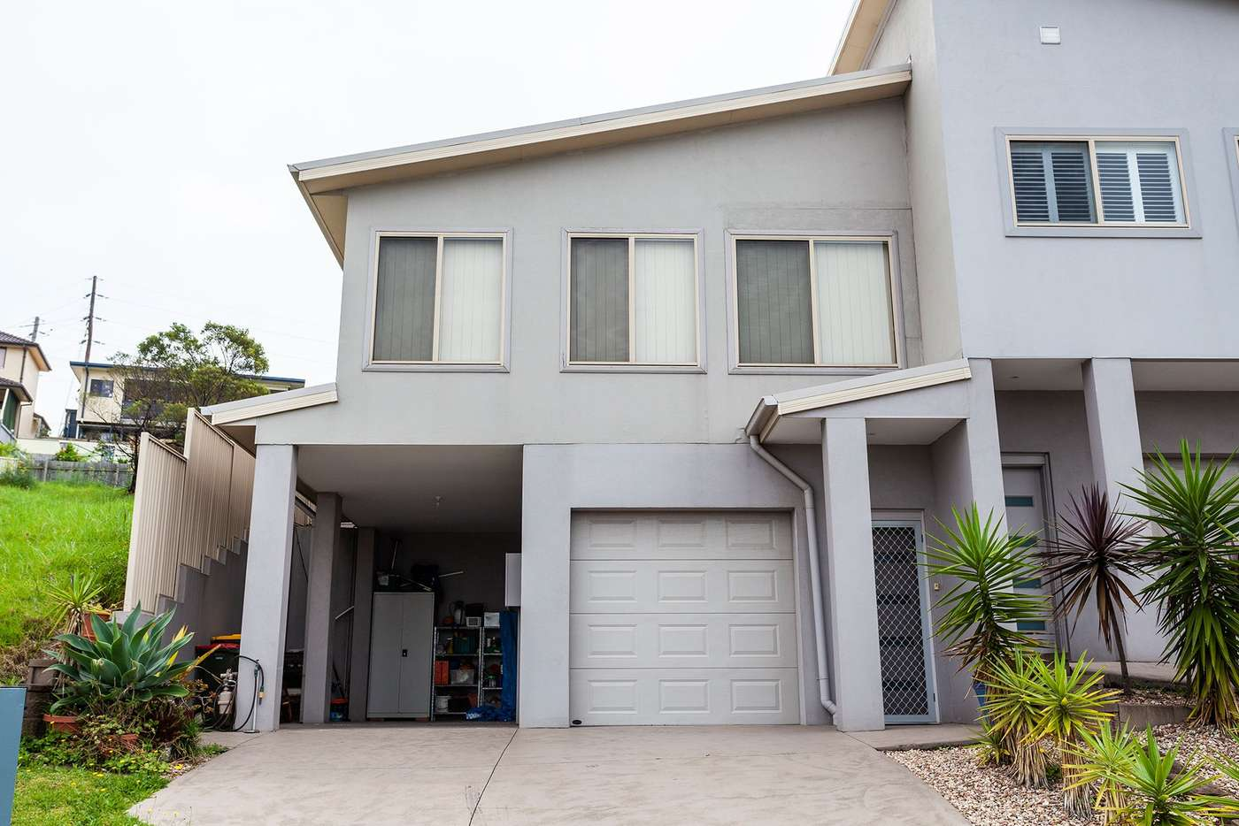 Main view of Homely townhouse listing, 2/19 Backhouse Road, Lake Heights NSW 2502