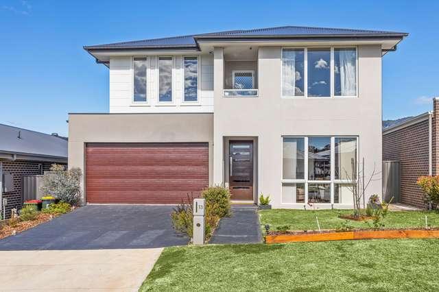 13 Scanlon Street, Calderwood NSW 2527