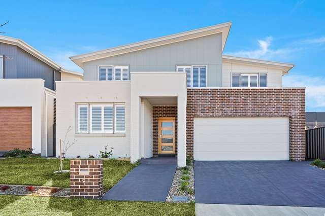 9 McNevin Close, Calderwood NSW 2527