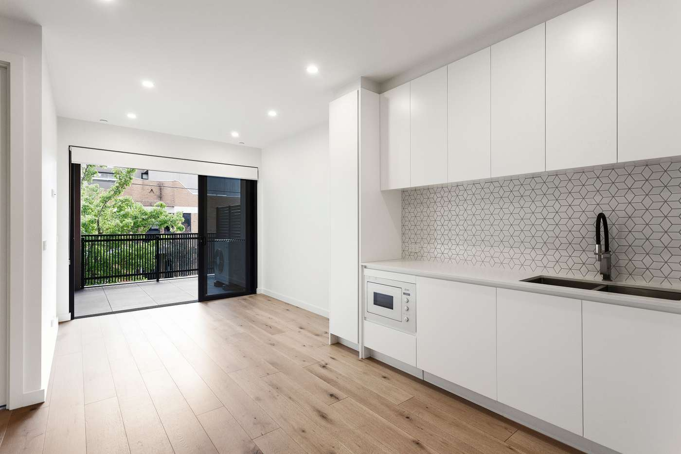 Main view of Homely apartment listing, 102/323 Neerim Road, Carnegie VIC 3163
