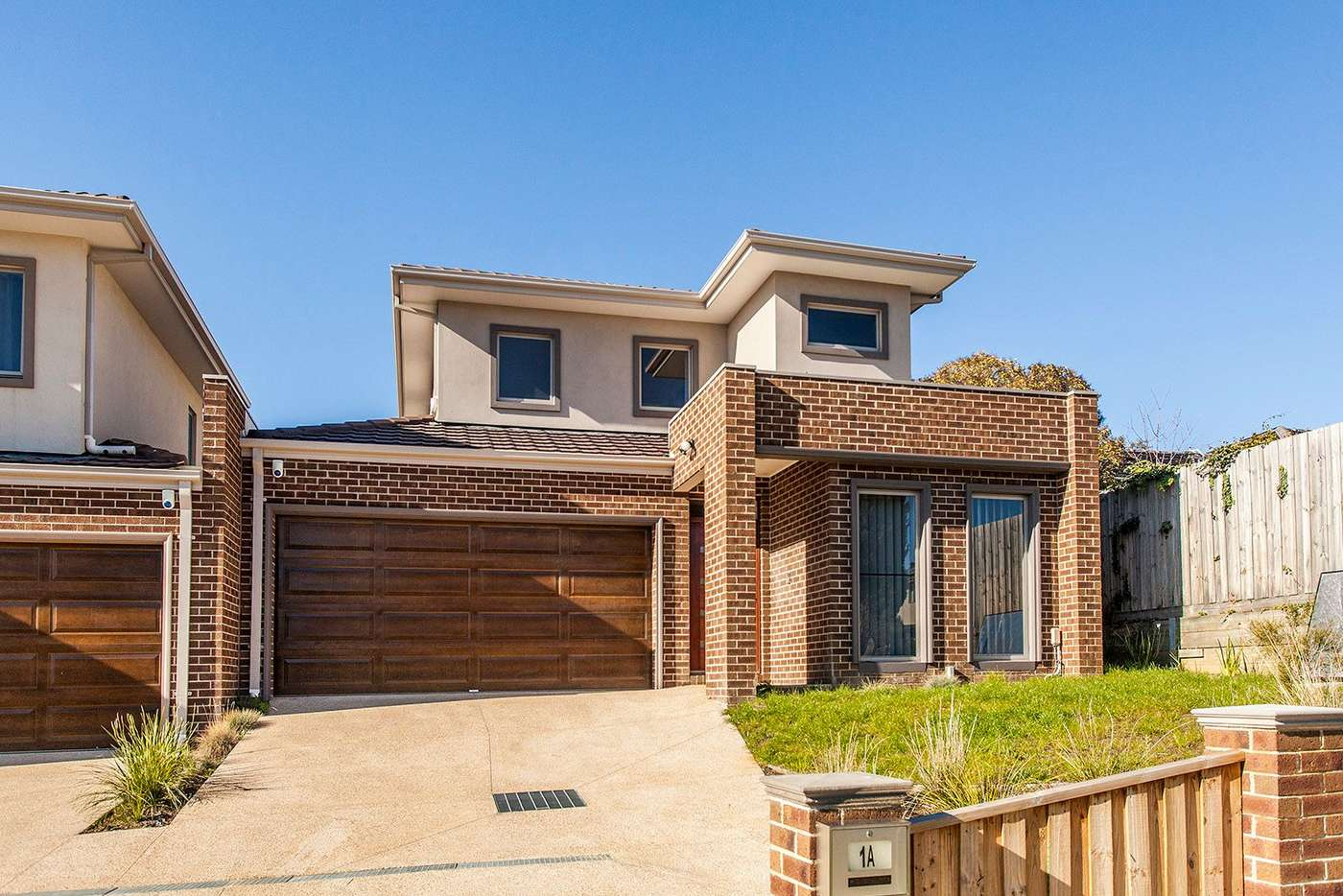 Main view of Homely townhouse listing, 1a Haldane Court, Doncaster East VIC 3109