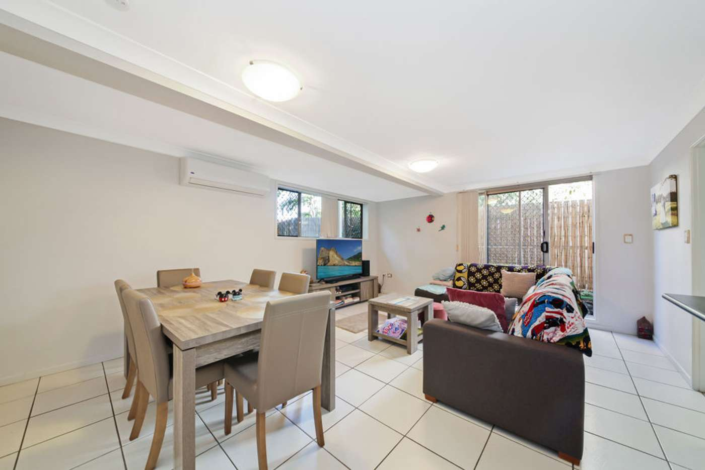 Main view of Homely townhouse listing, 1/65 Peach Street, Greenslopes QLD 4120