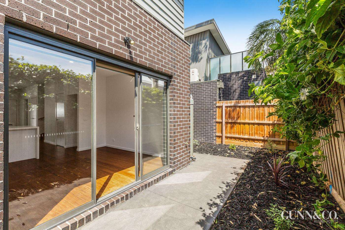 Main view of Homely townhouse listing, 12 Dolman Lane, Newport, VIC 3015