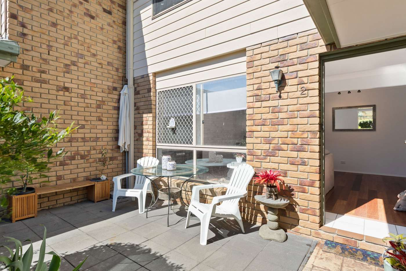Main view of Homely apartment listing, 2/12-16 Bottlewood Court, Burleigh Waters QLD 4220