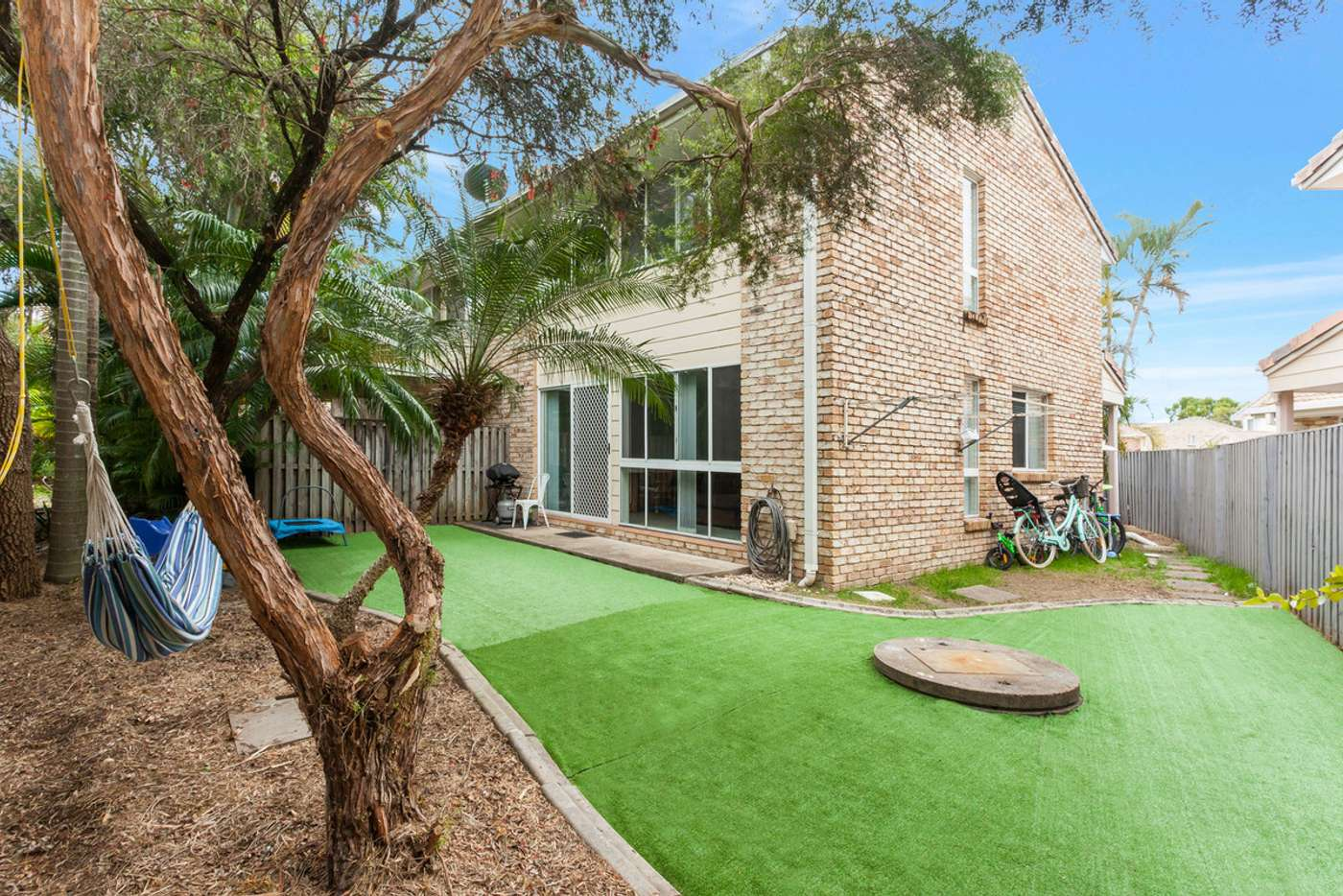 Main view of Homely townhouse listing, 9/9-15 Harrier Drive, Burleigh Waters QLD 4220