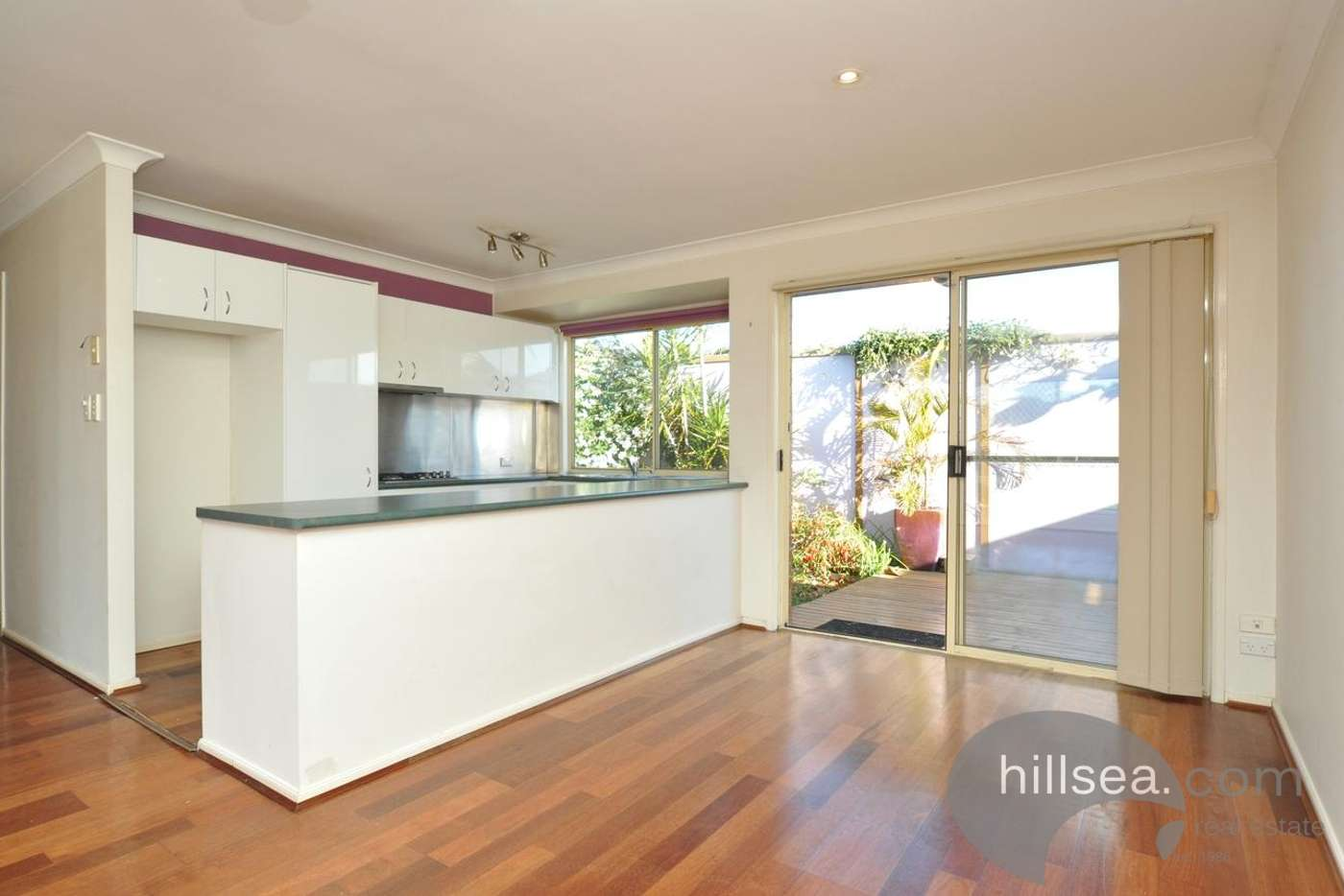 Main view of Homely semiDetached listing, 1/10 Crystal Reef Drive, Coombabah QLD 4216